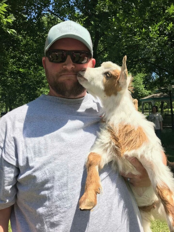 Mr. Hicks with mini goat